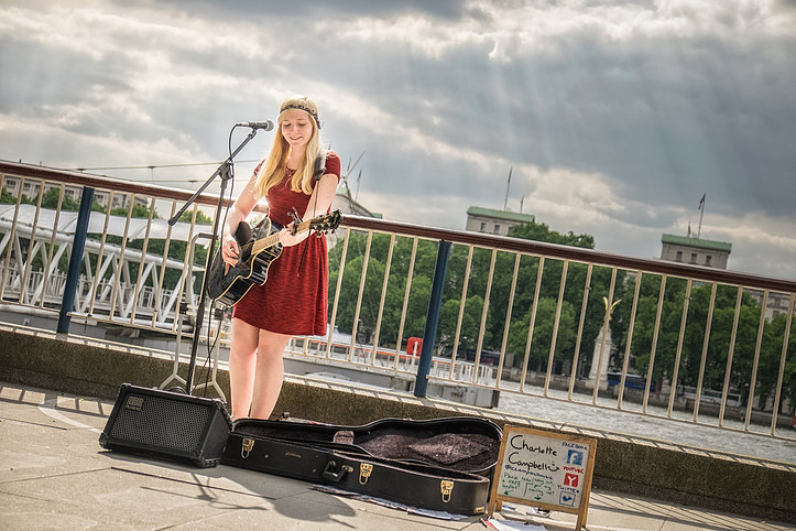Charlotte Campbell sings on the south bank