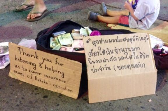 A beggar or a busker in Thailand