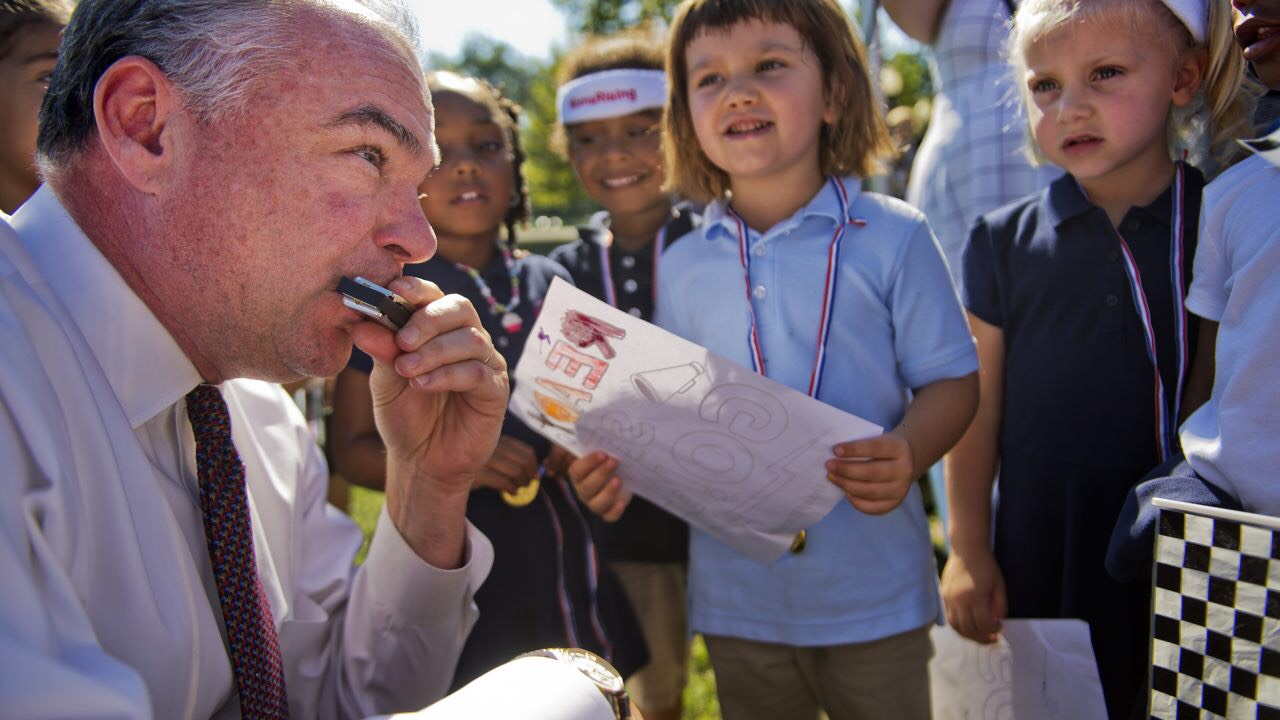 Tim Kaine playing the harmonica for some kids